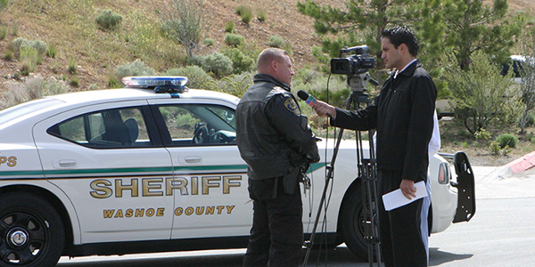 Media interviewing a Reno Officer with a Safety Message